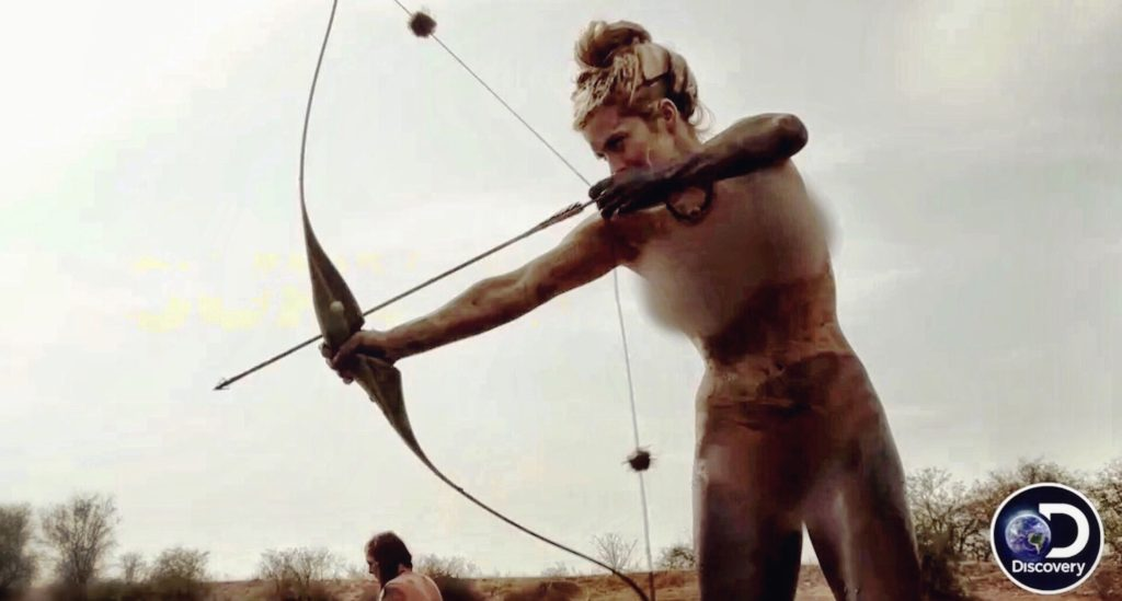Melissa Miller shooting her bow on Naked and Afraid