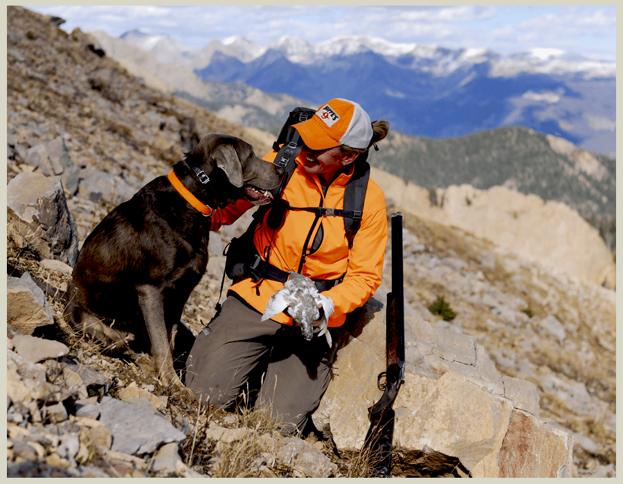 A women and dog bird hunting